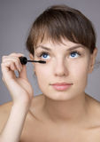 Girl who makes eyes make-up Stock Image