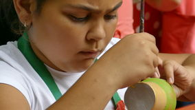 Girl who paints a ceramic bowl 1 stock footage