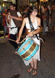 Girl who plays the drums in a medieval parade Royalty Free Stock Photography