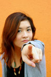 Girl who is pointing. She points due to curiousity Stock Photos