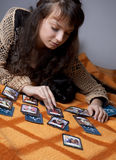 Girl who read the cards Stock Photo