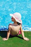 Girl who relaxes by the swimming pool Stock Photo