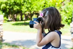 Girl who takes pictures in park Stock Photos