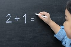 The girl who is thinking math problem stock images