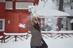 Girl who throw snow in the air Stock Photos