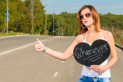 Girl who travels hitchhiking Royalty Free Stock Photos