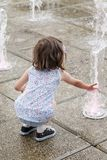 Girl who wallow in a fountain on a hot summer day Royalty Free Stock Photos