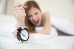 Girl who woke up very early to call an alarm clock Royalty Free Stock Photos