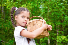 Girl with  wicker basket Royalty Free Stock Images