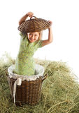 Girl in a wicker basket Royalty Free Stock Image