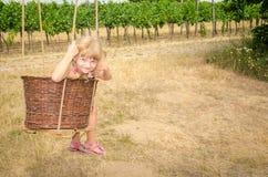 Girl in wicker basket Stock Photo
