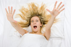 Girl wide awake. A young girl wide awake in bed Royalty Free Stock Image