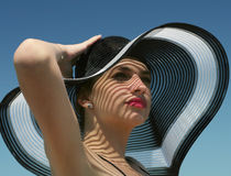 Girl in wide-brimmed hat. Beautiful young girl in wide-brimmed hat royalty free stock photo