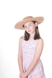 Girl in wide brimmed straw hat Stock Photos