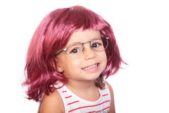 Girl and wig Royalty Free Stock Photography