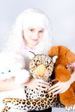 Girl in a wig with a toy Stock Photo