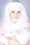 Girl in a wig with a toy Stock Photography