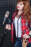 Girl wiht microphone Royalty Free Stock Images