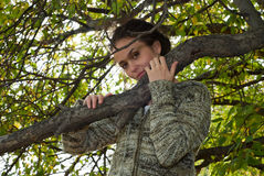 Girl and wild apple tree Royalty Free Stock Image