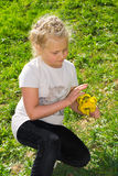 Girl with wild flowers Stock Photo