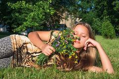 Girl with wild flowers Stock Image