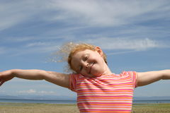 Girl wild and free. On the windy beach Stock Photography