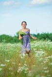 Girl with wild spring flowers Royalty Free Stock Photography