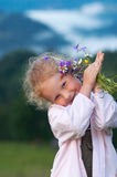 Girl and wildflowers Royalty Free Stock Images