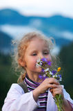 Girl and wildflowers Stock Images