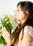 Girl and wildflowers Stock Photos