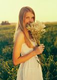 Girl with wildflowers Royalty Free Stock Images