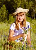 Girl with wildflowers. Summer day Royalty Free Stock Image