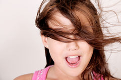 Girl and wind. Girl with hair in her face by wind Royalty Free Stock Image