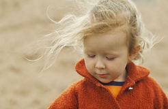 Girl and wind. Portrait of a little girl. The wind blows her long thin hair. Shallow DOF Stock Image