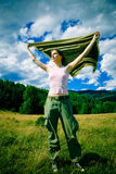 Girl in wind. A girl holding a blanket in the wind Royalty Free Stock Image