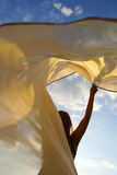 The girl and a wind. The girl with a fluttering coverlet Royalty Free Stock Image