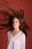 Girl in the wind flying hair Stock Photo