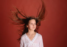 Girl in the wind flying hair Royalty Free Stock Images