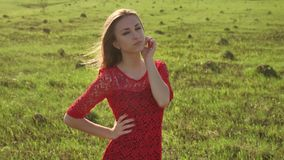 Girl wind nature. girl is standing in the field of green grass. Woman lifestyle freedom Stock Photos