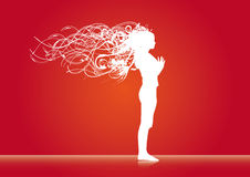 Girl in wind on red backround Stock Images