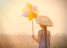 Girl with wind toy Stock Photos