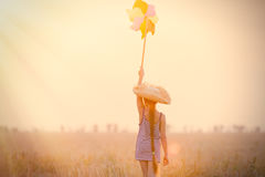 Girl with wind toy Stock Photography
