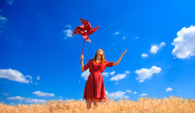 Girl with wind turbine Stock Photography