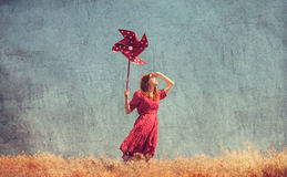 Girl with wind turbine. At field Royalty Free Stock Photos
