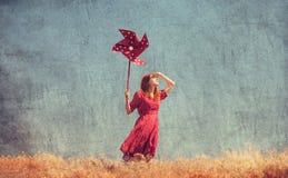Girl with wind turbine Royalty Free Stock Photos