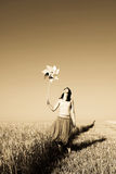 Girl with wind turbine at wheat field. Photo in age yellow style #3 Royalty Free Stock Photography