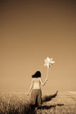 Girl with wind turbine at wheat field Stock Images