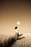 Girl with wind turbine at wheat field. Photo in age yellow style #5 Royalty Free Stock Photography