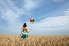 Girl with wind turbine at wheat field. Photo 4 Stock Photos