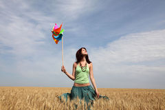 Girl with wind turbine at wheat field. Portrait of girl with wind turbine at wheat field. Photo front side #1 Stock Images